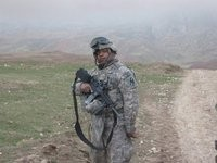 Wounded Warrior, Leonard, standing in Afghanistan mountains
