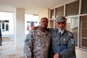 Leonard standing with Afghan
