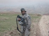 Lenny standing in Afghanistan mountains